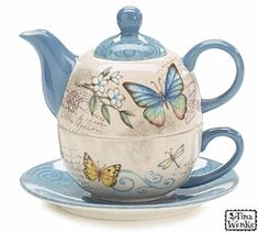 Blue Butterfly Tea for One Teapot. Mariposa motif with blue accents.Butterfly teacup sets on blue saucer.  Ceramic   Saucer: