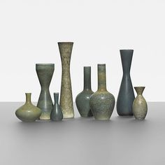 Carl-Harry Stalhane collection of eight vessels Rorstrand Sweden, c. 1950 glazed stoneware 2.75 dia x 12.25 h inches Incised signature and studio mark to underside of each example: [R Sweden CHS].
