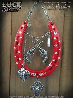 """""""RIO GRANDE"""" is a country girls dream! Bright red, glossy horseshoe, gunslingin' bling with a lucky heart, a silver cross and a bullet to spare! This shoe hangs from chunky, silver tone chain and has"""