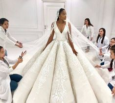 Wow! So beautiful. It really takes a village to get the perfect dress. Love it. Dress @michael5inco #AngolaBride #BellaNaijaWeddings