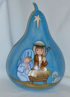 Precious Moments style Kids Nativity scene is painted on a gourd 10 tall and 25 around. It is based in shades of blue with a star shining down on