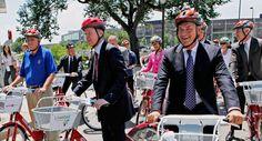 Governor (and former Denver mayor) Hickenlooper on a bike.