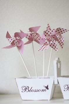 Escort cards Favor Polka Dot and Stipes Pinwheels Wedding Favor 12 Mini Spinnable Pinwheels (custom orders welcomed). $14.00, via Etsy.