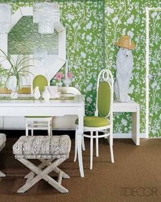 A groovy 1960s take on timeless Chinese Export patterns, the powerhouse green-and-white floral serves as an appropriate background for an assortment of vintage white furniture.