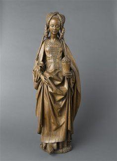 Wooden statue of Saint Mary Magdalene, with an amazing hairstyle. 4e quart 15e siècle - 1er quart 16e siècle (vers 1500). Paris, musée de Cluny - musée national du Moyen-Age.