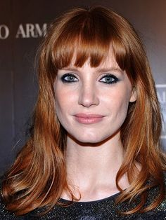 Jessica Chastain's choppy bangs and kohl-rimmed smoky eye makeup | allure.com