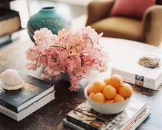 Bohemian Traditional Tablescape A rustic coffee table decorated with books and natural objects