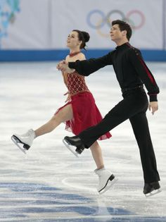Dancing on Ice  -  Russia wins team figure skating, 1st gold of Sochi - Tessa Virtue and Scott Moir of Canada compete in the team free ice dance figure skating competition at the Iceberg Skating Palace during the 2014 Winter Olympics, Sunday, Feb. 9, 2014, in Sochi, Russia. (AP Photo/Ivan Sekretarev)