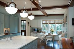 Droolworthy kitchen.  Love the pendants, color of cabinets, counters, window treatment and banquette.  Pretty much everything.