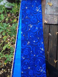 This blue cotton stole has a wonderful starry night sky design with gold stars, it is lined in a lighter blue cotton! It would be a unique stole