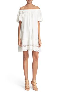 Adoring this fresh white off-the-shoulder dress featuring a comfortable, flowy silhouette for spring.