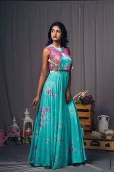 Sky blue and pink tie-dye dress with fringes. Floor length dress with net over coat.They can customize the dress as per your requirement.For more detail 12 March 2018 Indian Gowns Dresses, Indian Fashion Dresses, Indian Designer Outfits, Satin Dresses, Designer Dresses, Long Gown Dress, Frock Dress, Saree Dress, The Dress
