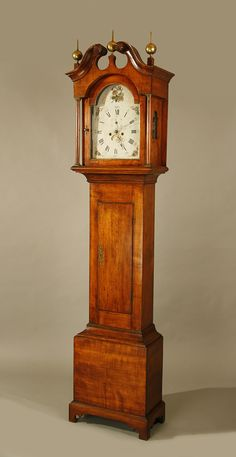 A classic New Hampshire Chippendale tall clock with fully-carved pinwheels at center of bonnet and molded, applied bracket base. The dial is painted with flowers at the top and in the corners. Antique Grandfather Clock, Antique Clocks, Primitive Furniture, Antique Furniture, Classic Furniture, Tick Tock Clock, Pendulum Clock, Clock Shop, Retro Clock