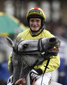Neptune Collonges and Daryl Jacob, the 2012 winners of the Grand National. The first grey since Nicolaus Silver in 1961 to win, he gave Paul Nicholls his first National winner. Neptune was retired immediately after the race.