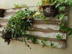 Suporte para vasos de plantas com Pallet.