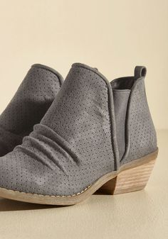 Every journey needs a solid beginning, and yours starts with these stone grey booties from Report Footwear. Slip into the faux suede finesse of this perforated pair - replete with slouchy ankles and stacked heels - and feel confident that any trek you take today will be a stylish success!