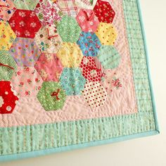 Paper Pieced Mini Hexagon Quilt - no tutorial, but a cute idea!