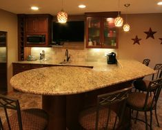 Basement bar area with granite counters and seating. www.jbrothershi.com