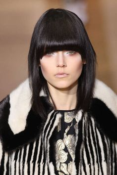 Bangs are the ultimate hair accessory this season. Whether they're full and square, short and rounded or just swept to the side, bangs frame the face and accentuate the eyes.