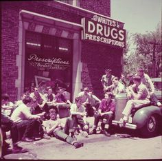 New Trier High School students hanging outside White's Drugs pharmacy. Photograph by Alfred Eisenstaedt. New Trier, Illinois, 1950.