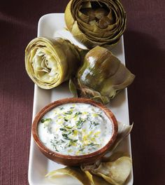 Memorial Day snacking doesn't have to be bad for your waistline. Check out this yummy Steamed Artichokes with Lemon Herb Sauce recipe: http://cleaneatingmag.com/recipes/classics-made-clean/steamed-artichokes-with-lemon-herb-sauce/