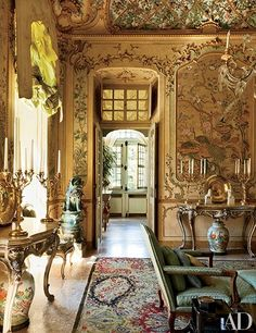 Eighteenth-century painted-stucco decorations enliven the main salon on the piano nobile; the consoles are Piedmontese antiques, and the open doors lead to the famous Chinese Gallery.