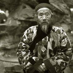 A Taoist Monk Wearing Patchwork Clothes, Beijing 1994  Liu Zheng  Gelatin Sliver Print, 46 x 46cm, Edition 10, 37 x 37cm, Edition 20, 2007