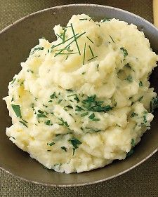 Prepare mashed potatoes, omitting herbs, up to 1 day ahead; refrigerate. Reheat in a bowl set over a pot of simmering water; stir in herbs.
