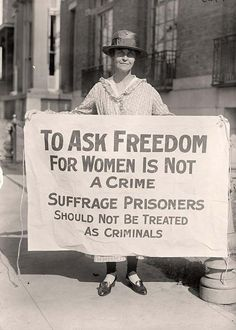 """A woman suffrage activist protesting after """"The Night of Terror."""" [1917] 33 suffrage activists had been arrested for 'obstructing traffic' and were badly beaten by prison guards."""