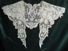 Irish Carrickmacross Needle Lace shawl or collar.Irish Carrickmacross Needle Lace is one of the oldest Irish needle laces. This lace, like most other laces, derived its name from the area of origin. It was introduced around 1820, near the town of Carrickmacross, in the county of Monaghan. There were two types of Irish Carrickmacross made at that time, Guipure and Applique.