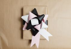 How to Make a Colourful Paper Present Topper with Craft Designer Kitiya Palaskas.