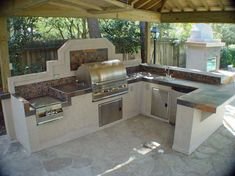 Majestic Tile Outdoor Kitchen Countertop With Stone Mosaic Tile Kitchen Backsplash Multicolor Slate And Polished Chrome Kitchen Sink Faucet On Stone Slab Flooring