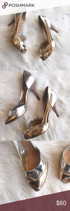 """Giuseppe Zanotti D'Orsay Metallic Heel Used condition Giuseppe Zanotti D'Orsay silver/gold metallic Peep-toe Heels. Heel is approximately 3.5"""". These have scuffs along exterior, back ankle and front toe and some creasing, please see photos. Wear on exterior is from storage most likely since the bottom soles are in excellent condition.  These are in used condition, price reflects flaws. These are authentic and still have the Sale price tag from SAKS. Size 40. Giuseppe Zanotti Shoes Heels"""