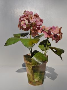 Vieuxtemps Porcelain, Pink hydrangea, porcelain flowers and pot. Leaves and stem are tole....