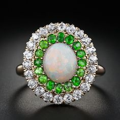 Edwardian ring with opal, green garnets and European-cut diamonds in yellow & rose gold