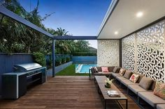 Custom made wall panels and wooden deck shape the barbecue area