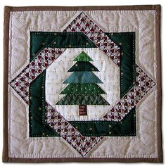 Unify the 'Christmas Tree Variety' quilt pieces by using this square around all the different trees.