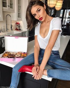 Sexy star: Olivia Culpo, 25, didn't disappoint with her sexy social media shots in a low-c...