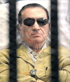 FILE - In this Saturday, June 2012 file photo, Egypt's ex-President Hosni Mubarak lays on a gurney inside a barred cage in the police academy courthouse in Cairo, Egypt. An Egyptian prison official