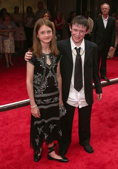 "Maybe it's because she had to pose with her sweaty co-star, Devon Murray (aka Seamus Finnigan)? | 23 Bewitching Photos From The ""Harry Potter And The Prisoner Of Azkaban"" Premiere"