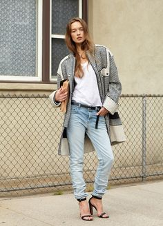 Shop this look on Lookastic:  http://lookastic.com/women/looks/overcoat-and-jeans-and-sandals-and-crew-neck-t-shirt-and-clutch-and-belt/1657  — White and Black Horizontal Striped Coat  — Light Blue Jeans  — Black Heeled Sandals  — White Crew-neck T-shirt  — Beige Leather Clutch  — Black Leather Belt