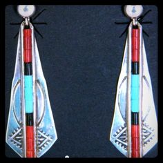 """Navajo Signed .925 Turquoise Coral Jet Earrings Irresistibly eye catching, this pair of vintage Navajo Native American sterling silver multi gemstone dangle earrings on French wires were crafted by Lester Jackson. The hallmark """"LJ"""" & """"Sterling"""" are on each. The enticing design was hand stamped with turquoise, red coral,& jet center beads. Weight is 4 g. The Navajo lapidary artist is a magician at puzzling together stones to create eye pleasing works of art. He has used a combination of…"""