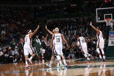Dudley and Marshall of the Milwaukee Bucks celebrate after a made shot during the game on January 2, 2015 at BMO Harris Bradley Center in Milwaukee, Wisconsin.