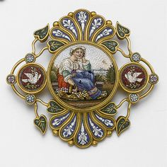 GOLD AND MICROMOSAIC BROOCH, CIRCA 1870. The circular mosaic depicting a seated woman in peasant costume holding a basket of grapes, within an elaborate frame of gold wire and beadwork further decorated with mosaics of doves, floral sprigs and leaves, the reverse with glazed compartment