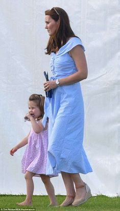 The Duchess of Cambridge wore a £39.99 striped dress by Zara while at a charity polo match... #katemiddleton