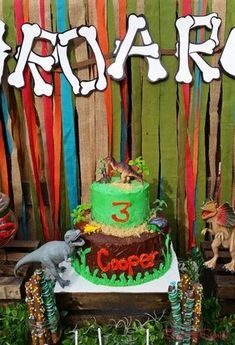 Awesome dinosaur birthday party cake! See more party planning ideas at CatchMyParty.com!