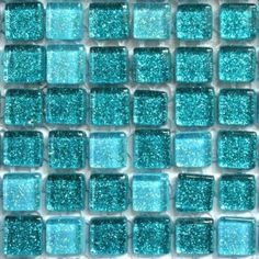 Sparkly aqua and turquoise glass tiles - what a spa like experience this would create in my future rainhead shower!