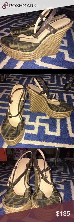 "Fendi Wedge Zucca Espadrilles Sandals Shoes Fendi Wedge Zucca Espadrilles Sandals Shoes Size: 38.5 EU = 8-8.5 US (I think they fit an narrow size 8 better) Color: Brown & Tan ""FF"" Monogram Canvas w/ leather ankle strap that fastens w/ a metallic buckle closure Wedge Heel Height: 4.724'' Platform Height: 0.787'' Gently Worn. Canvas upper material & leather ankle strap in excellent condition as is the braided espadrille wedge. Soles show normal wear, Fendi logo under heel has faded & material…"