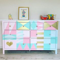 disney house decor Dont want to paint a mural on your walls? Paint it on your dresser! Dresser goals by Love a great Disney inspired DIY! Thank you so much for sharin Disney Home Decor, Disney Diy, Disney Furniture, Disney Bedrooms, Changing Table Dresser, Pin On, Disney Nursery, Little Girl Rooms, Small World