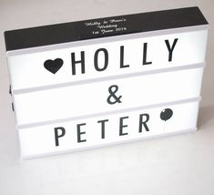 Personalised cinematic light box with changable letters.Black shell with black letters and symbols comes with: A4 B3 C3 D3 E4 F2 G3 H3 I4 J2 K3 L3 M3 N3 <em>Ñ2 </em>O4 P3 Q1 R3 S3 T3 U2 V2 W2 X2 Y3 Z2 @ ! ? # & heart x 2 star x2 White shell with pastel colour letters comes with: A4 B2 C2 D2 E4 F2 G2 H2 I3 J2 K2 L3 M2 N2 O3 P2 Q1 R3 S3 T2 U3 V2 W2 X1 Y2 Z1 @ ! ? # & heart x 1 star x1 numbers 0123456789 Typical character set consists of 85 tiles:Fantastic fun lightboxes come in ...
